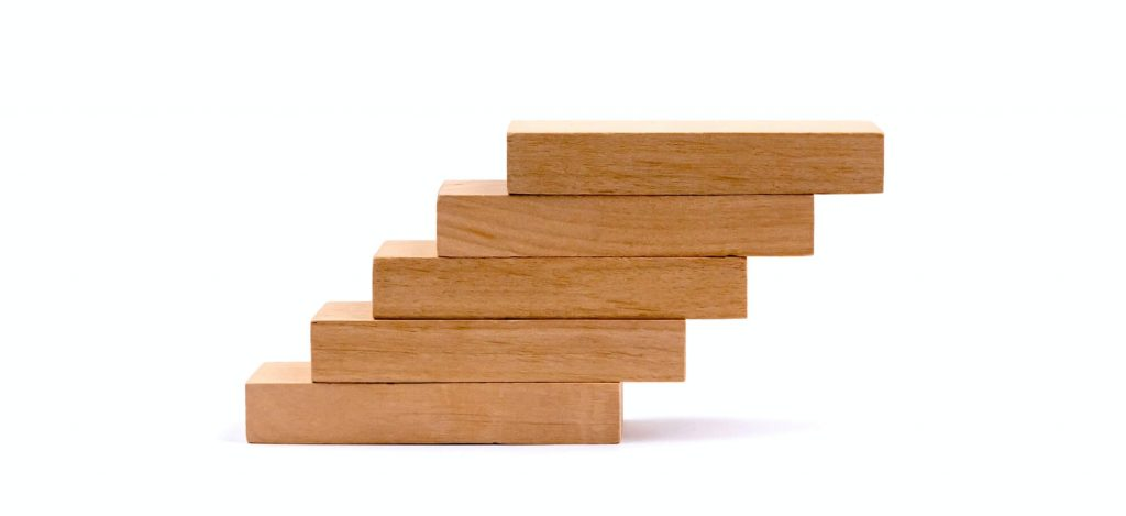 Brand positioning depicted with wooden blocks